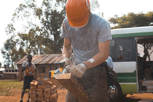 Image of a single worker in a foreign country providing aid