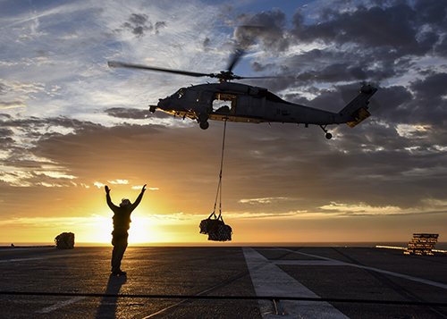Image of a worker on a helicopter landing pad