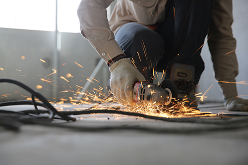 Image of a worker using a grinder