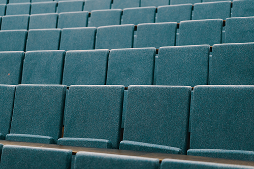 Image of empty blue seats