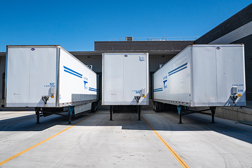 Image of a row of tractor trailer containers
